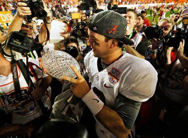 http://www.si.com/college-football/campus-union/2013/05/20/alabama-bcs-trophy-auction